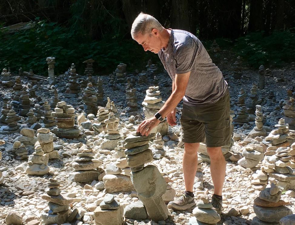 John building cairns.